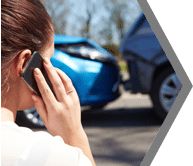 Woman on phone after car accident: personal injury services